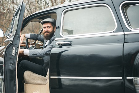 Travel and business trip or hitch hiking. travel by car of bearded hipster