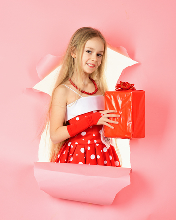 Birthday and christmas. Small girl with shopping package, black friday. Child girl with present pack, cyber monday. Boxing day, holiday celebration and party. Childhood and happiness, gift box. Stock Photo
