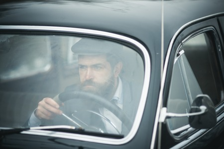 business trip of bearded man in retro car. business trip and traveling concept