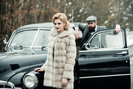 security guard of luxury woman. securoti guard man and girl in retro car Reklamní fotografie