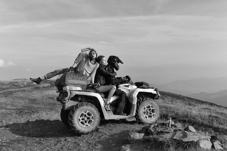 Man and girls ride quad