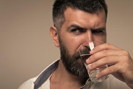 Bearded man drink water