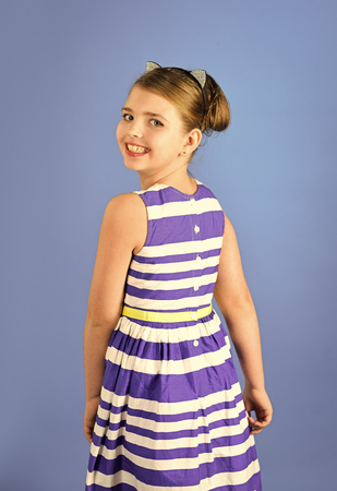 portrait of pretty small girl child with elegant hair. potrait of little girl child. Stock Photo