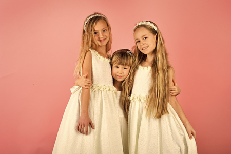 Little girls in fashionable dress, prom. Children girls in dress, family, sisters. Friendship, look, hairdresser, wedding. Family fashion model sisters, beauty Fashion and beauty little princess
