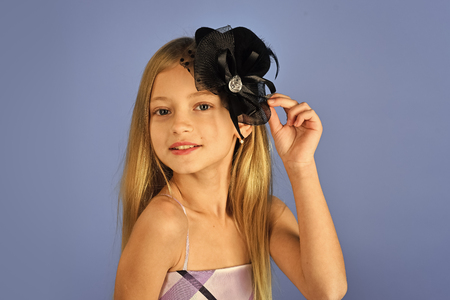 Child girl in stylish glamour elegant dress. child girl has beautiful hair