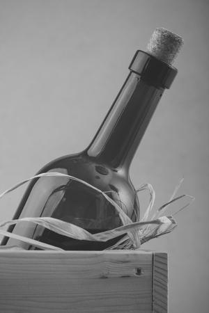 Uncorked bottle of wine in box Reklamní fotografie