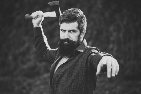 Man with sharp axe Stock Photo