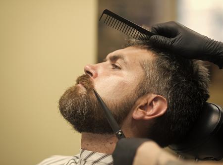 Man cut long beard and mustache with scissors. Banco de Imagens