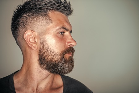 Macho with bearded face profile and stylish hair Reklamní fotografie