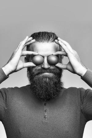 smiling bearded man with egg Stok Fotoğraf