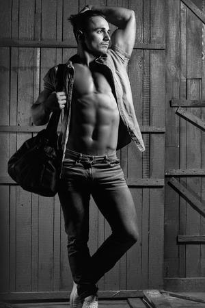 Mens heals body care. Stylish guy with bag Фото со стока