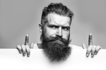 bearded thougtful man with paper