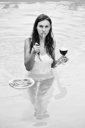 girl smoking with watermelon and wine in pool Banque d'images