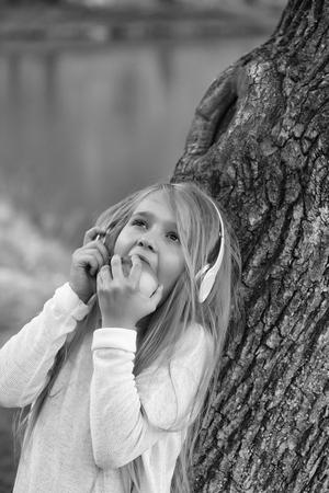 small girl in music hearphone Stock Photo