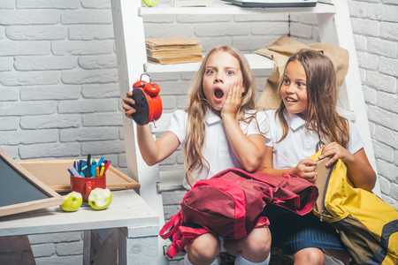 time management concept. time management of kids holding alarm clock. Stock Photo