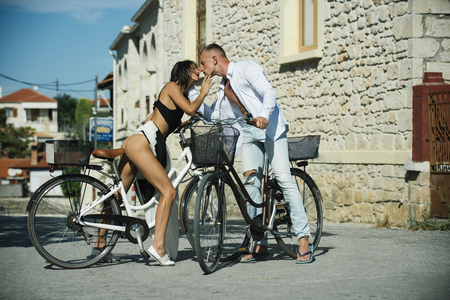 bike trip of family on valentines day. Summer holidays and travel vacation. Love relations of young couple of friends. travel on bicycle of couple in love. date and meeting of sexy woman and man.