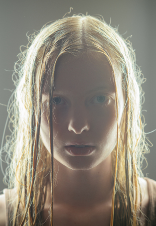 Woman with wet blond long hair. Sensual woman with natural beauty look and no makeup. Albino girl with blue eyes and white skin. Natural beauty and skincare.