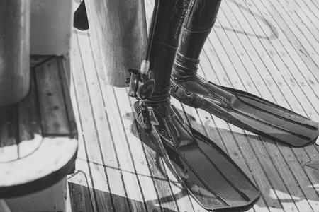 Legs in black rubber wetsuit and flippers Foto de archivo - 101674222
