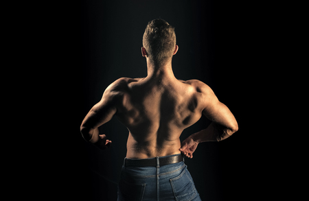 Bodybuilder man with muscular torso back Stock Photo