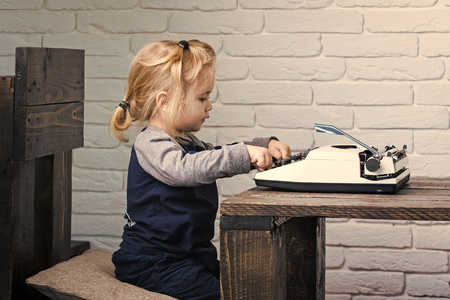 kid or small boy or businessman child with typewriter Фото со стока