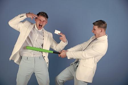 Businessman batting rival with baseball bat Banco de Imagens