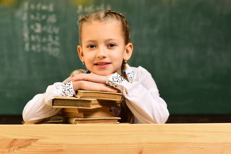 Tutor will require child to learn specific skill before advancing to level. University studying friends studying and reading books in classroom. Help with homework widely required among schoolkids now Фото со стока