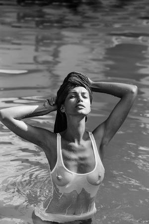 Fashion woman body. pretty sexy woman in swimming pool