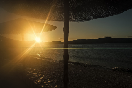 Silhouettes of parasols at sunset Stock fotó