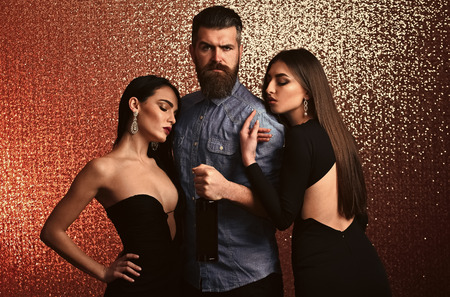 Couple secrets fantasy. Bearded man with women on glitter background