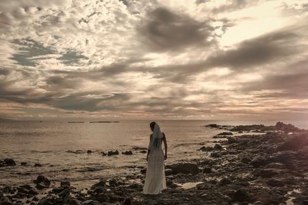 Pretty bride in white sexy wedding dress with veil