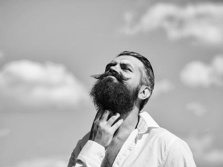 Elegant Man in Suit. Bearded man on blue sky Stok Fotoğraf