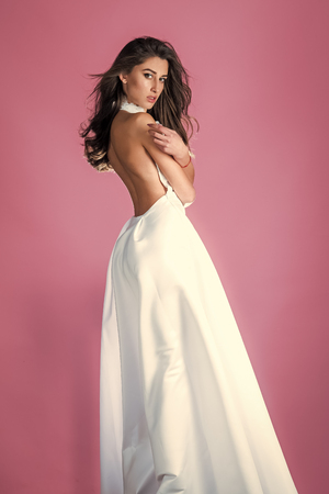 Sensual woman body. Beautiful fashion woman brunette hair makeup wear silk white long dress for party date sexy woman pretty face perfect body birthday girl bridesmaid bride wife wedding day clothes Stock Photo - 101653877