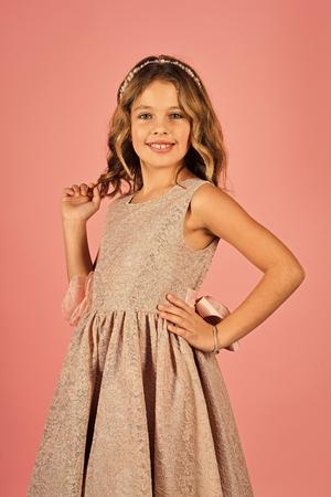 Beautiful little girl model wearing a pink dress Stock Photo
