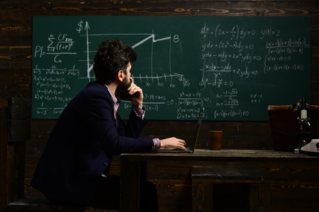 Hipster is solving math exam. Back to school. Teacher lets students know that they can depend not only on her. Student needs safe learning environment. Teacher sets high expectations for his students.