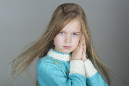 Adorable 5-year old blue eyed little girl of European appearance 写真素材