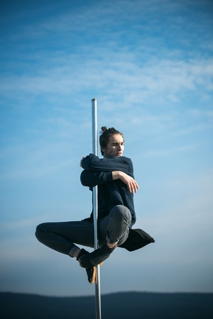 Sexy macho man fly on blue sky background. sexy macho sitting on pole on blue sky background