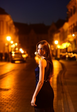 Fashion and beauty of business lady. Sexy girl in elegant dress. Girl with glamour makeup. Luxury woman in evening dress at night city going to prom party Night city with princess in celebrity style.
