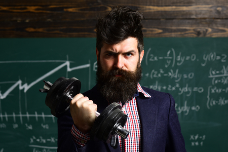 college students studying and reading together in class education concepts. learning and people concept. Hipster is solving math exam. Teacher can make lasting impact.