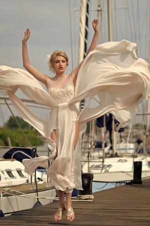 Happy woman. Pretty fiancee in yacht club Stock Photo