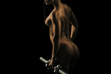 Sensual woman. Woman with naked body at workout. Standard-Bild