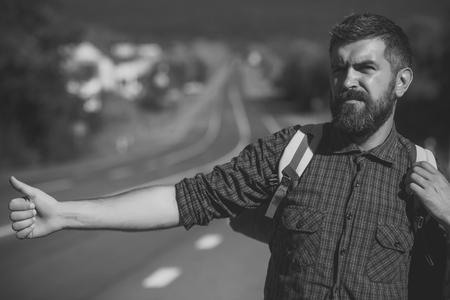 Man with serious emotion. Tourist traveler travel auto stop