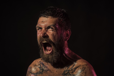 Handsome man face. Bearded man with angry face shout on black background