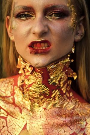 High fashion portrait of elegant woman. Girl vampire with bloody streaks