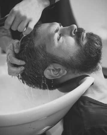 Mens heals body care. man with serious face in barbershop, new technology.