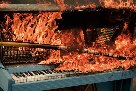 Piano on fire, keyboard, smoke. piano on fire burning Stock Photo
