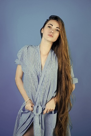 Sexy woman. Woman or girl with long hair in striped dressing gown