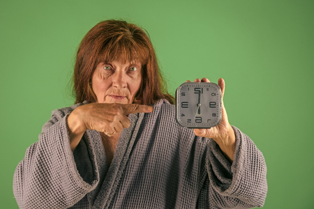 Retirement and pension. Time management and business success. Woman with long hair hold alarm clock. 写真素材