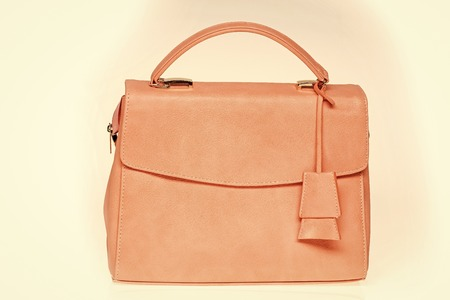 Bag or handbag of coral color, leather material