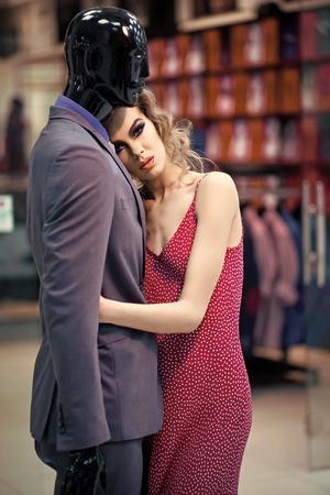 Fashion woman body. Woman hugging mannequin