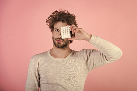 Handsome man face. Health and medicine, hangover. Mens heals care. Stock Photo